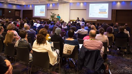 People listening to a speaker at a conference in Salzburg about clinical care and research in Epidermolysis Bullosa